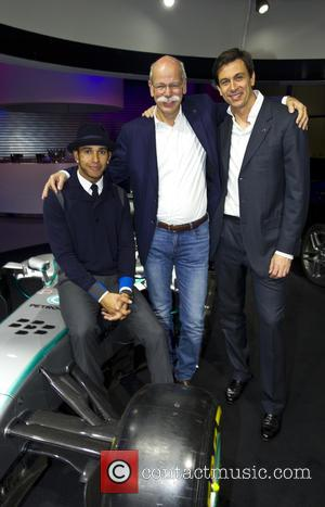 Dr. Dieter Zetsche, Toto Wolff and Lewis Hamilton