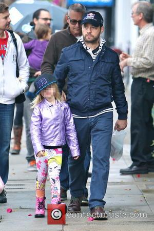 Jason Priestley and Ava Veronica Priestley - Jason Priestley takes a walk in the rain with his family through Studio...