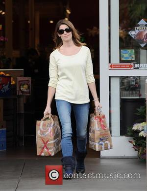 Photographs of American actress and model Ashley Greene as she shops for groceries after having been out of town for...