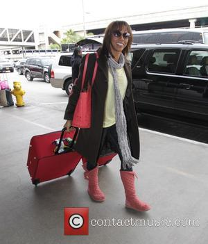 Holly Robinson Peete - Holly Robinson Peete departs from Los Angeles International Airport (LAX) wearing colour co - ordinated peach...