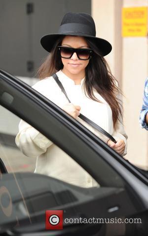 Pregnant Kourtney Kardashian Strips For Dujour Magazine