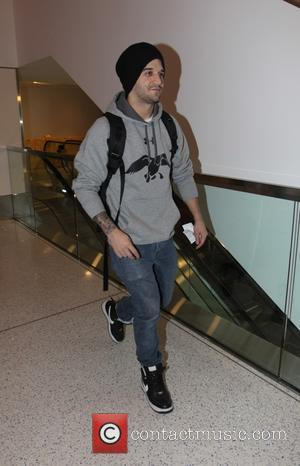 Mark Ballas - Mark Ballas departs from  Los Angeles International Airport (LAX) in beanie hat and hoodie - Los...
