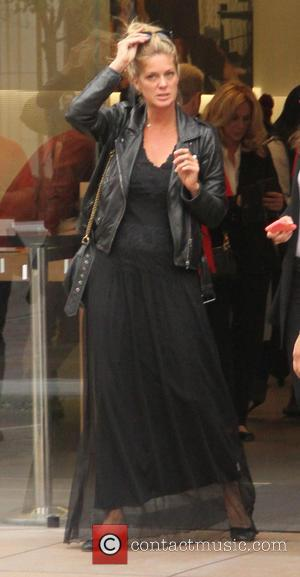 Rachel Hunter - Rachel Hunter goes shopping at The Grove in Hollywood dressed all in black with a leather jacket...