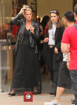 Rachel Hunter and Renee Stewart - Rachel Hunter goes shopping at The Grove in Hollywood dressed all in black with...
