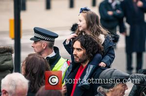 Russell Brand - Russell Brand joins a group of east London residents protesting against rising rent prices at the New...
