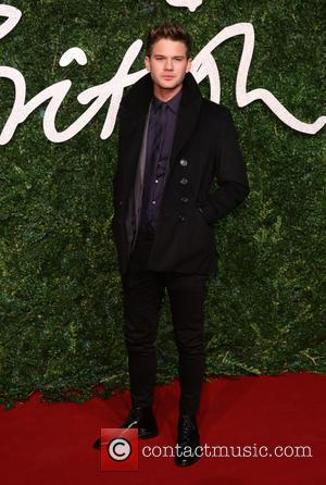 Jeremy Irvine - Shots of a host of stars as they took to the red carpet for the 2014 British...