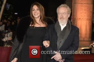 Ridley Scott and Giannina Facio - Photographs of a variety of celebrities as they took to the red carpet for...