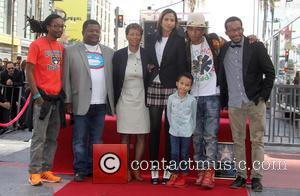 Pharrell Williams, Helen Lasichanh, Rocket Ayer Williams and Family - Pharrell Williams honored with a star on the Hollywood Walk...
