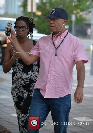 Tangie Murray and Russell Simmons