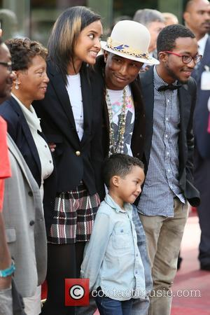 Pharrell Williams, Helen Lasichanh, Rocket Williams and Carolyn Williams
