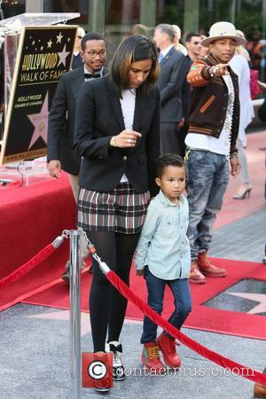 Pharrell Williams, Helen Lasichanh and Rocket Williams - American pop star Pharrell Williams was presented with a Hollywood walk of...