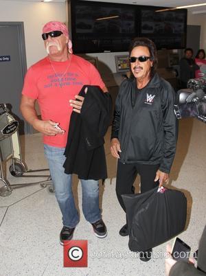 Hulk Hogan and Jimmy Hart - Hulk Hogan and professional wrestling manager Jimmy Hart arrive at Los Angeles International Airport...