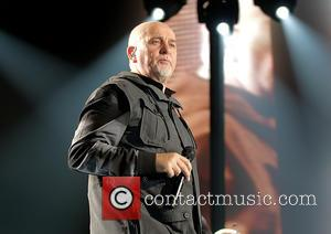 Peter Gabriel - Photographs of British singer songwriter Peter Gabriel as he performed live in concert as part of his...