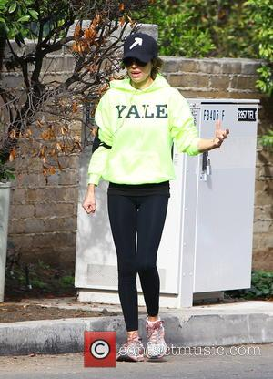 Lisa Rinna - Lisa Rinna wearing a bright, fluorescent green hoodie with the word 'YALE' printed across the chest while...