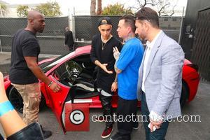 Corey Gamble and Justin Bieber - Justin Bieber meets fans at West Coast Customs Empire Takeover Auto Show - Los...