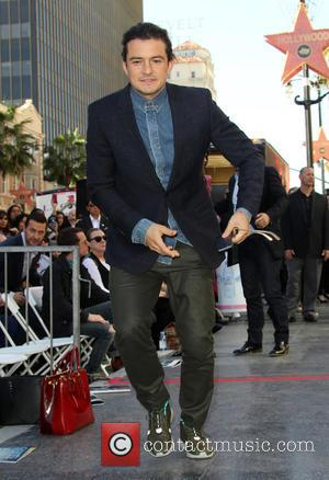 Orlando Bloom - Director Peter Jackson honored with a star on the  Hollywood Walk of Fame at THE HOLLYWOOD...