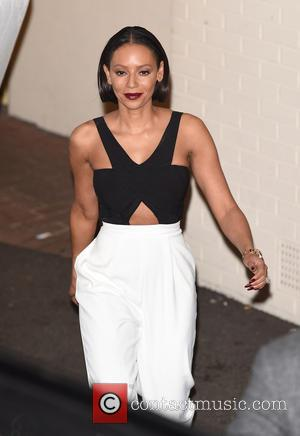 Mel B Dismisses Family Problems With Christmas Day Photo