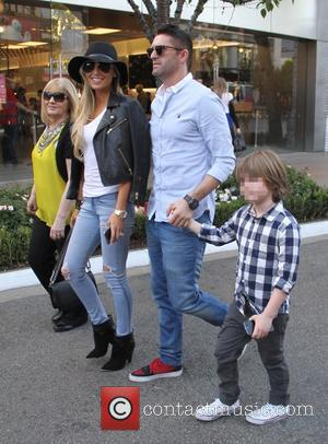 Robbie Keane, Claudine Keane and Robert Keane - Robbie Keane shops with his family at The Grove - Los Angeles,...