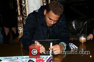 Chris Brown - Chris Brown and Karen Bystedt Exclusive Serigraph Signing Benefit Symphonic Love Foundation at Guerilla Atelier Clothing Store...