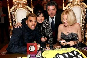Chris Brown, Sonia Ete, Thierry Ete and Karen Bystedt - Chris Brown and Karen Bystedt Exclusive Serigraph Signing Benefit Symphonic...