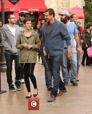 Jason Segel - Jason Segel with a female companion goes shopping at The Grove in Hollywood - Los Angeles, California,...