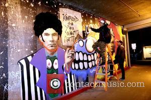 Chris Brown - Chris Brown and Karen Bystedt show off their artwork at Andy Warhol Goes Street at Blick Art...