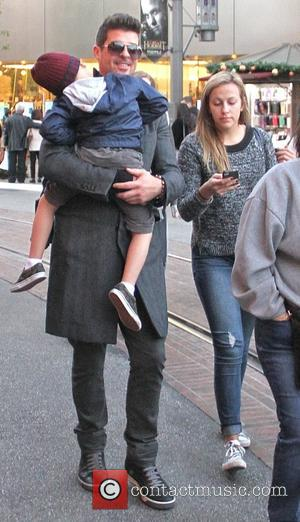 Robin Thicke and Julian Fuego Thicke - Robin Thicke carries his son Julian while out shopping at The Grove in...