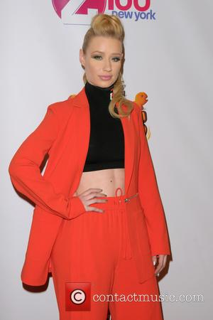 Iggy Azalea Drops Team Video Amid Personal Drama