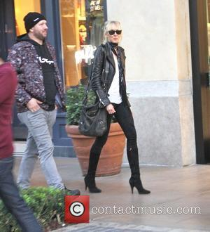 Kimberly Stewart - Kimberly Stewart goes Christmas shopping at The Grove in Hollywood with a male companion - Los Angeles,...