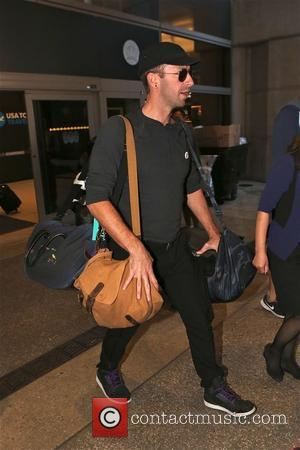Chris Martin - Chris Martin arrives s at LAX airport in Los Angeles - Los Angeles, California, United States -...