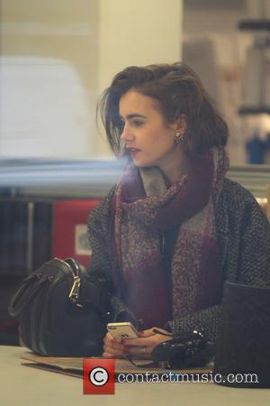 Actress and daughter of Phil Collins, Lily Collins was spotted as she shopped at a Frame Store in West Hollywood,...
