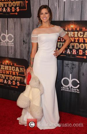 Cassadee Pope - Shots of a host of celebrities as they took to the red carpet for the 2014 American...