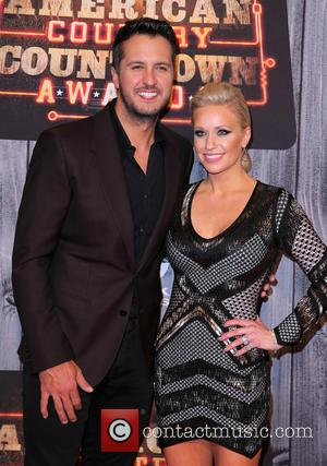 Luke Bryan and Caroline Bryan - Shots of a host of celebrities as they took to the red carpet for...