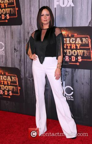 Sara Evans - Shots of a host of celebrities as they took to the red carpet for the 2014 American...
