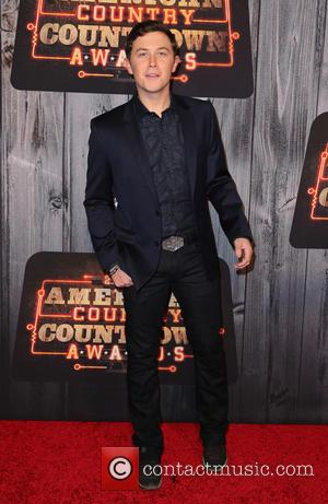 Scotty McCreery - Shots of a host of celebrities as they took to the red carpet for the 2014 American...