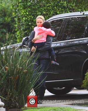 Charlize Theron and Jackson Theron - Charlize Theron dashes out from her black BMW SUV wearing all black with black...