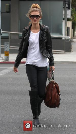 AnnaLynne McCord - AnnaLynne McCord walking to her car after having lunch with a female friend at Urth Caffé. She...