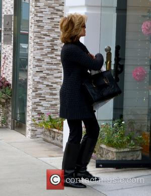Jane Fonda - Jane Fonda on Brighton Way in Beverly Hills looking chic in black but for carrying a white...