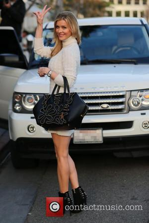 Joanna Krupa - Joanna Krupa gets affectionate with a dog while having lunch with her husband Romain and friends at...