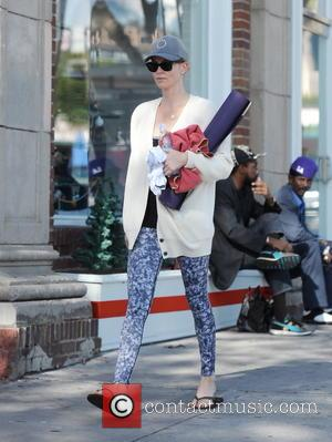 American Hollywood actress Charlize Theron was photographed carrying a purple yoga mat as she left a yoga class in West...