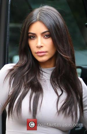 Can You Guess What Kim Kardashian's Very Kim Kardashian Reason For Not Smiling In Pictures Is?
