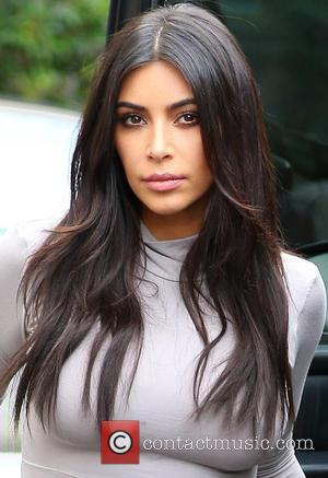 Kim Kardashian Puts Her Cleavage Up Front On 'Selfish' Book Cover