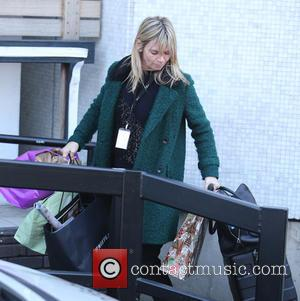 Zoe Ball - Zoe Ball has her hands full of luggage and bags outside the ITV Studios - London, United...