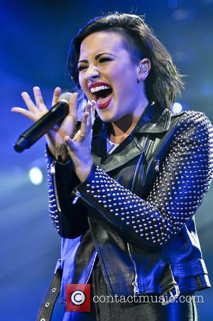 Demi Lovato Preaches Self-love And Acceptance As She Ushers In 2015