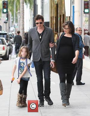 Milla Jovovich, Paul W. S. Anderson and Ever Gabo Anderson - Pregnant Milla Jovovich spotted out with her husband Paul...