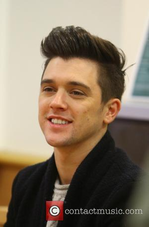 JJ Hamblett - Union J sign copies of their new album 'You Got It All' at Morrison supermarket at Morrisons...