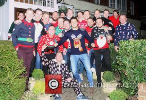 Mark Wright and Mark Wright Sr. - Mark Wright, along with family and friends, wear Christmas jumpers on an evening...