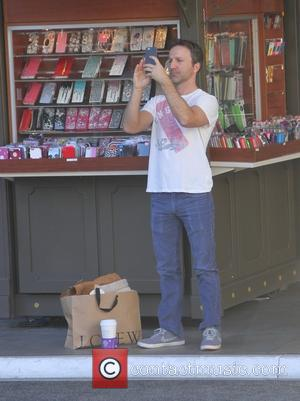 Breckin Meyer - Breckin Meyer wearing an England t-shirt goes shopping at The Grove in Hollywood - Los Angeles, California,...