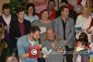 Brendan O'Carroll and Brian McFadden & Carolers - Celebrities attend the annual Christmas Ward Walk 2014 at Our Lady's Hospital...