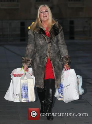 Vanessa Feltz - Vanessa Feltz arrives at Radio 1 to carrying several Christmas presents and a bag featuring a photograph...